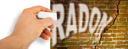 Foto de Hand removes radon gas from a cracked brick wall with radon gas escaping - concept image with copy space - Imagen libre de derechos