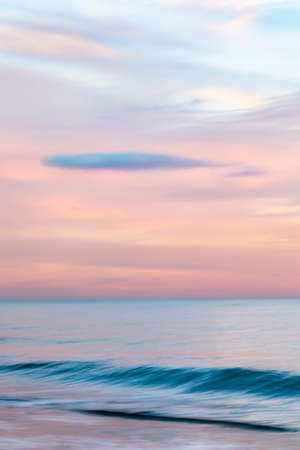 Photo pour abstract landscape of sea. texture water, sky and sand in blurry motion in tropical sunset colors - image libre de droit