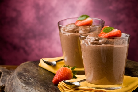 phot of delicious chocolate mousse with strawberries and yellow napkins