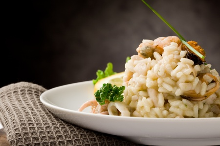Photo for photo of delicious risotto with seafood and parsley on it  - Royalty Free Image