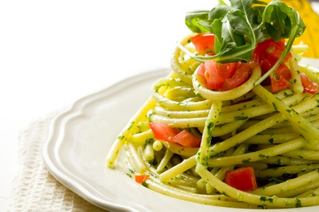 delicious pasta with arugula pesto and cherry tomatoes