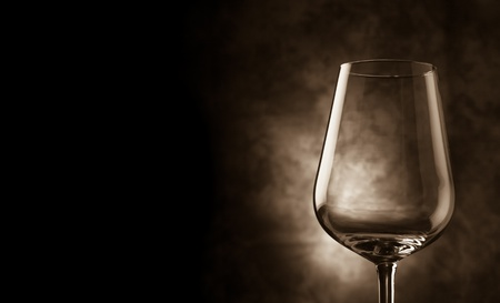 photo of wine glass cover in fronto of rural background