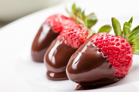 delicious strawberries with melted chocolate
