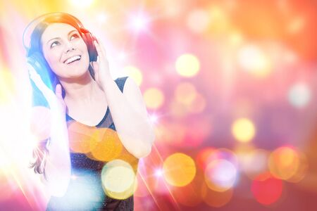 Conceptual photo of smiling woman listen to music in front of a colorful background