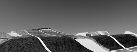 Geometric stone roofs at Cidade da Cultura in Santiago de Compostela, Galicia, Spain. Black and white processed