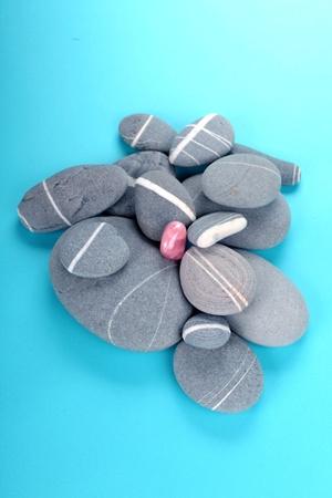 pink crystal over rocks