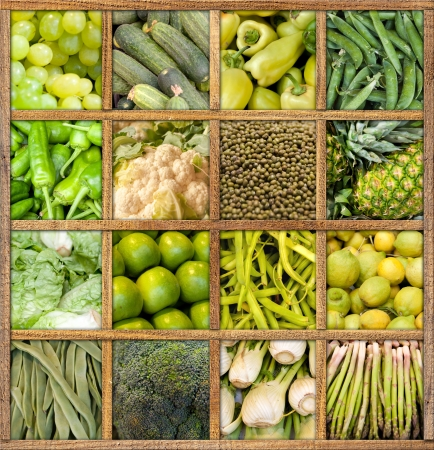 Composition of fruit and vegetables framed in wood