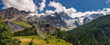 Panoramic Summer view of the mountains and glaciers in Ecrins National Park (Bec de L'Homme, La Meije, Glacier du Tabuchet) from the village of La Grave. Hautes-Alpes, PACA Region, Southern French Alps, France