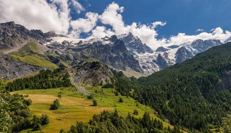 Summer view of the mountains and glaciers of the Ecrins National Park (Bec de L'Homme, La Meije, Glacier du Tabuchet) from the village of La Grave. Hautes-Alpes, PACA Region, Southern French Alps, France