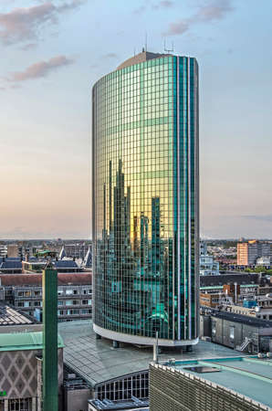 Rotterdam, The Netherlands, August 31, 2018: view of the  WTC highrise, architect Rob van Erk, 1984, constructed on top of the pre-war Beurs building