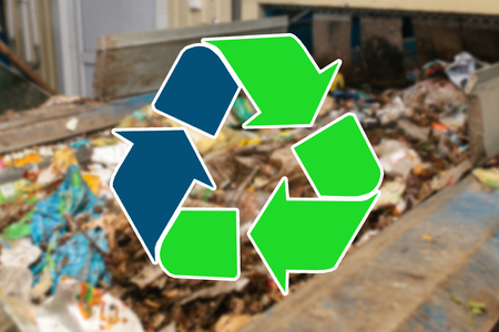 Photo pour Sign recycling waste. The waste sorting and processing plant is blurry in the background - image libre de droit