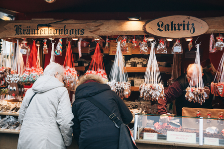 Berlin, December 25, 2017: People choose Christmas gifts at the traditional decorated Christmas market in Berlin, Germany.
