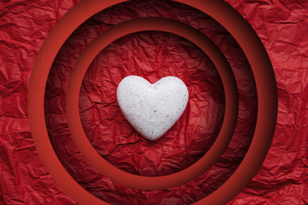 Photo for White heart on a red background. Paper cut. Concept for Valentines Day or Womens Day or the topic of health, life, donation and help. In minimal style. - Royalty Free Image