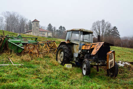 Photo pour old tractor on the field, foggy morning - image libre de droit
