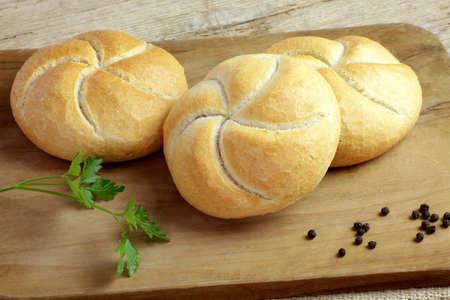 Foto für individual round rolls on a cutting board - Lizenzfreies Bild