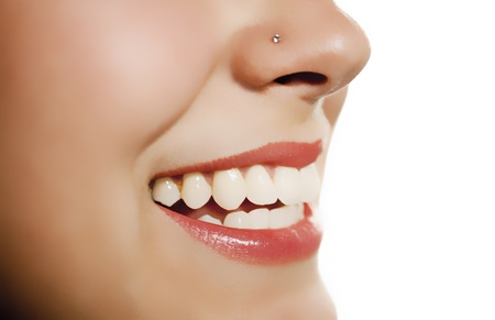 woman mouth smiling showing tooth over white background