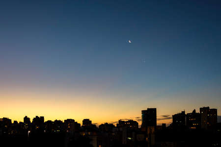 Outline of the buildings of the Moinhos de Vento neighborhood in Porto Alegre during the evening