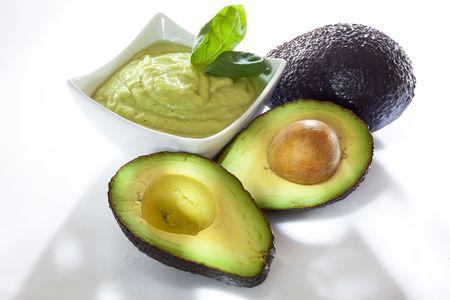 Avocado mousse with halved avocados