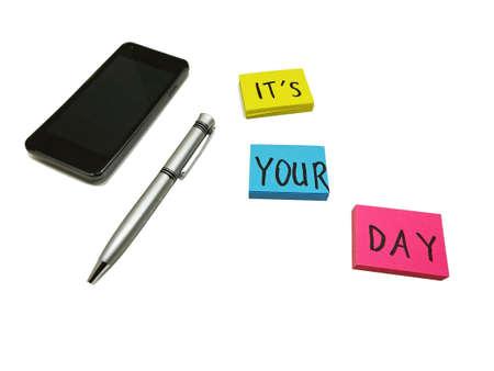 Photo pour Color sticker leaves placed on white board with mobile phone and pen - image libre de droit
