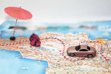 Photo for Abstract idea of rent a car. Small car on map. - Royalty Free Image