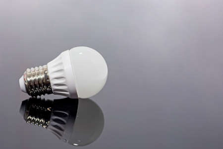 Photo for Modern LED lamp on a dark mirror background. - Royalty Free Image
