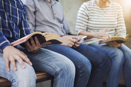 Foto de Three christian friends study bible together in church Sunday school class - Imagen libre de derechos