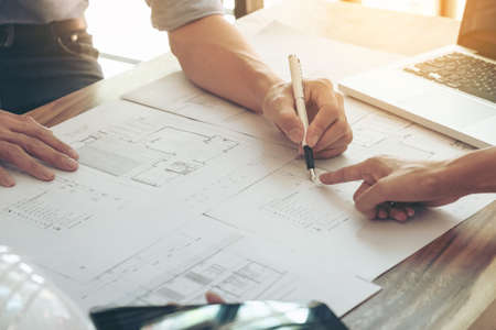 Photo pour Image of engineer or architectural project, two engineering discussing and working on blueprint with architect equipment, Construction concept. - image libre de droit
