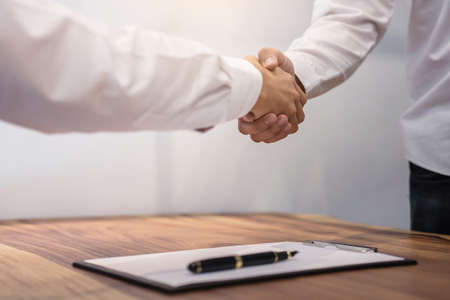Photo pour Real estate broker agent and customer shaking hands after signing contract documents for realty purchase, Bank employees congratulate, Concept mortgage loan approval. - image libre de droit