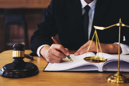 Photo pour Judge gavel with Justice lawyers, Businessman in suit or lawyer working on a documents. Legal law, advice and justice concept. - image libre de droit
