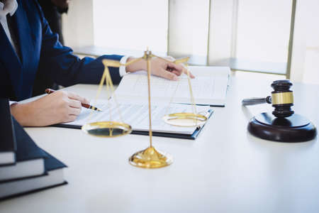 Photo pour Teamwork of business lawyer colleagues, consultation and conference of professional female lawyers working having at law firm in office. Concepts of law, Judge gavel with scales of justice. - image libre de droit