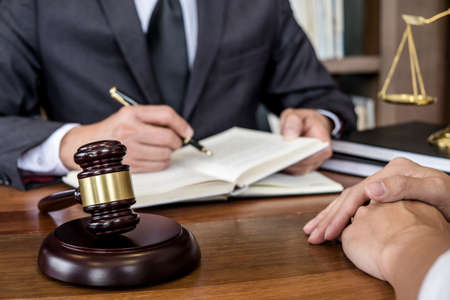 Photo pour Judge gavel with scales of justice, Businesswoman and male lawyers or counselor discussing contract papers at law firm in office. Concepts of law. - image libre de droit