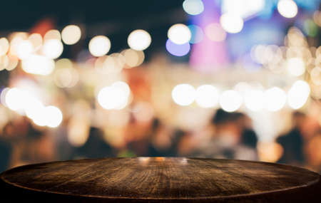 Photo pour Selective Empty wooden table in front of abstract blurred festive light background with light spots and bokeh for product montage display of product. - image libre de droit