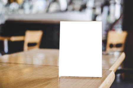 Photo pour Mock up acrylic frame posters pattern template forms background, blank menu frame on table in coffee shop stand for your text of display your product. - image libre de droit
