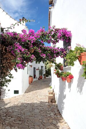 Narrow, cobbled streets and pretty houses of Spanish Pueblo at Castillo de la Frontera in Andalucia southern Spain