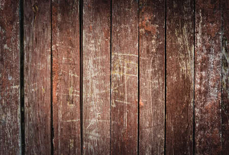 Old brown wooden textured background with vignetting