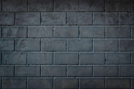 Photo pour Background of smoothly laid cinder blocks. Wall of bricks with vignetting. - image libre de droit