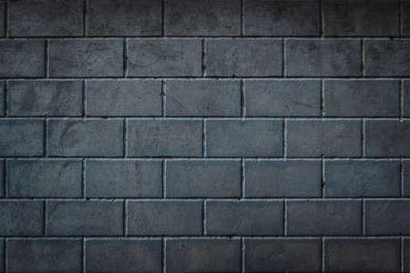 Foto de Background of smoothly laid cinder blocks. Wall of bricks with vignetting. - Imagen libre de derechos