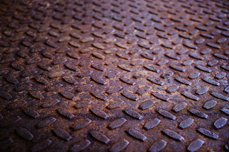 Photo pour Old and rusty metal floor. Texture of a rough metal sheet with a convex pattern - image libre de droit