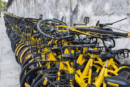 ZHONGSHAN;GUANGDONG;China-Mar 4;2018:shared bikes put aside the road.Too many shared bikes in China and quite some of them have been abandoned.