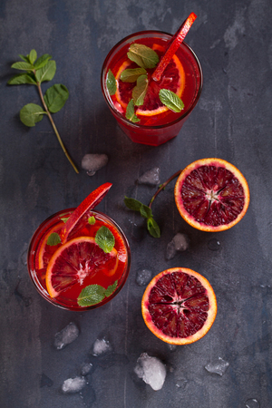 Photo for Blood orange cocktail with slices of citrus fruits and mint. View from above, top  - Royalty Free Image