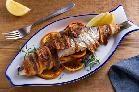 Photo pour Grilled Bacon-Wrapped Whitefish. Fish wrapped with bacon - image libre de droit