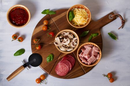 Photo pour Pizza toppings. Ingredients for pizza on white background - image libre de droit
