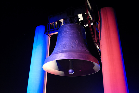 ROVERETO, ITALY - NOVEMBER 16, 2015: The great Peace Bell Dolens Mary  lit up with the Tricolor in a show of support for the people of France following the deadly terrorist attacks in Paris.