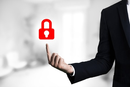 beautiful Business male arm indicating lock icon.