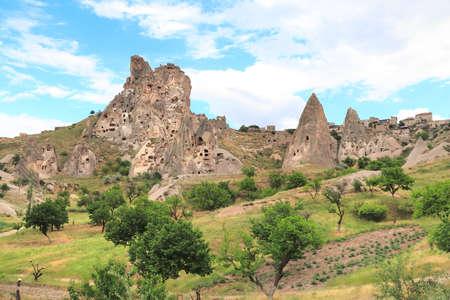 Foto für Carved houses in rocks in Pigeon Valley, Uchisar, Cappadocia, Turkey - Lizenzfreies Bild