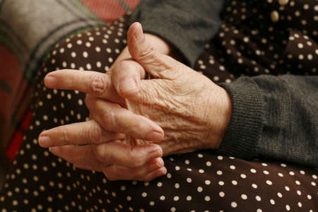 Hands of the elderly woman close-up