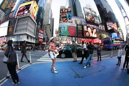 NEW YORK - OCTOBER 11: Robert Burck, the Naked Cowboy with guitar, entertains the crowd in Times Square on October 11, 2012 at New York City, NY.