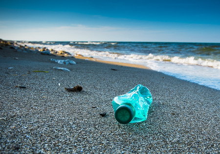 Photo for Pollution and inorganic waste on sea beach  - Royalty Free Image