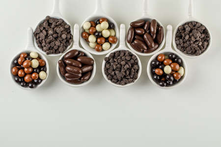 Photo pour Assortment of chocolates in scoops on white background, top view.  - image libre de droit