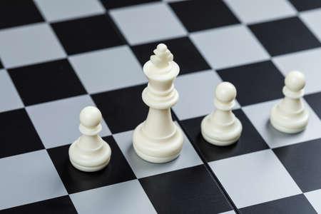 Foto de Conceptual of strategy and chess. on checkerboard background high angle view. horizontal image - Imagen libre de derechos